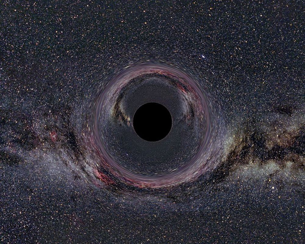A simulated black hole within the Milky Way and the distortion of spacetime around it. (Image Credit: Ute Kraus, Physics education group Kraus, Universität Hildesheim, background image: Axel Mellinger)