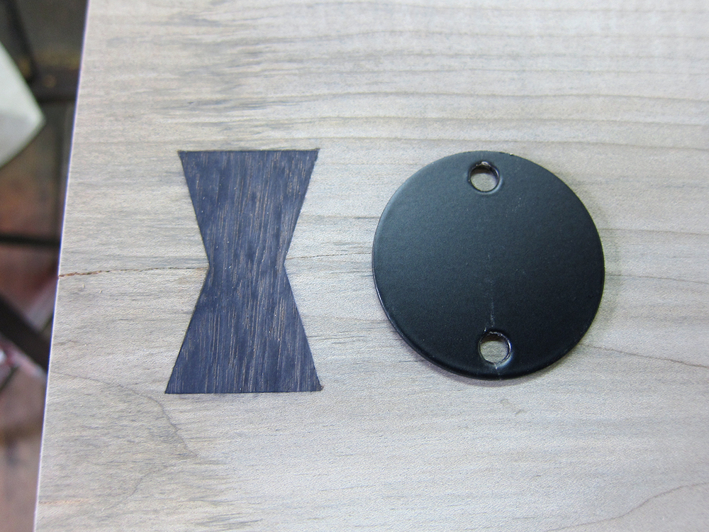 All elements together: Ebonized maple and walnut and matte black powder coat finish.