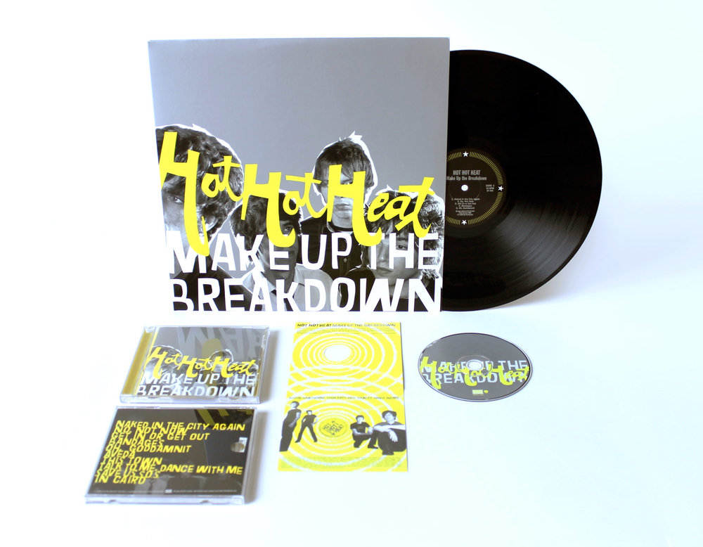 Hot Hot Heat  Make Up the Breakdown   Metallic silver, fluorescent yellow and black inks give the package impact. Additionally, putting the band's photo on the cover, but covering it up with lettering simultaneously references the band's image-conscious look   and their punk roots.