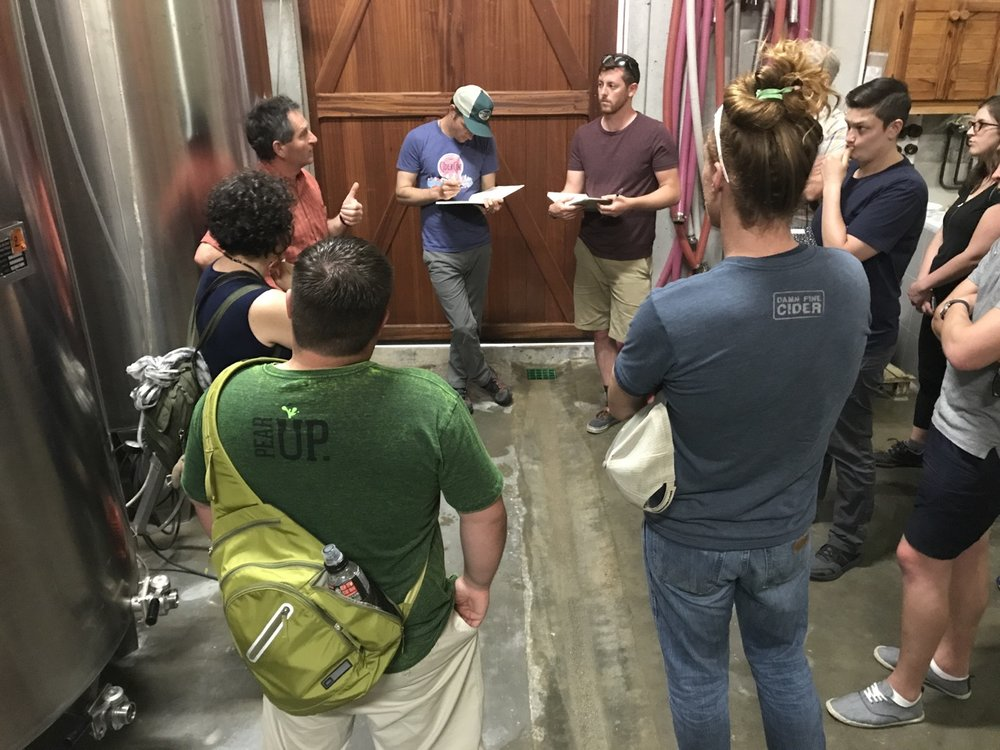 Our cidermakers engrossed in some serious learning.