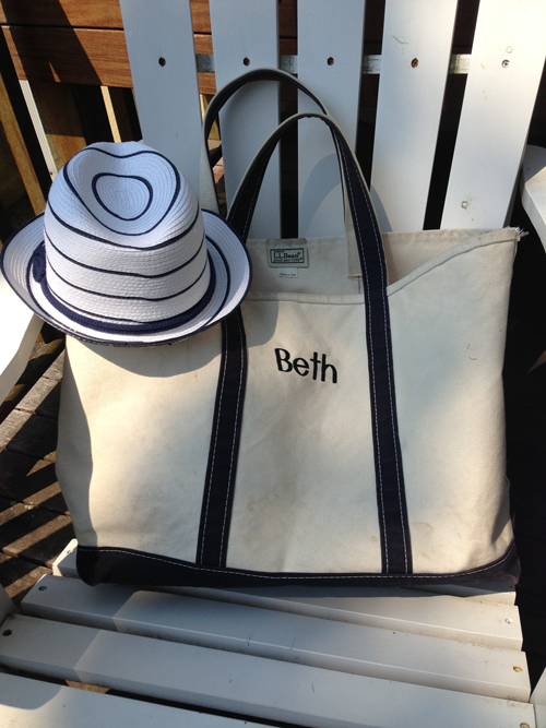 I start with my favorite worn-in L.L. Bean tote and a new summer hat from She La La in New Canaan, CT.