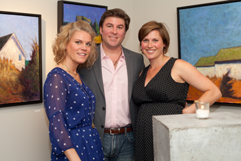 Drawing Room owners Kenleigh & Mike Larock and gallery curator Cameron Schmitz stand in front of works from this summer's En Plein Air exhibition.