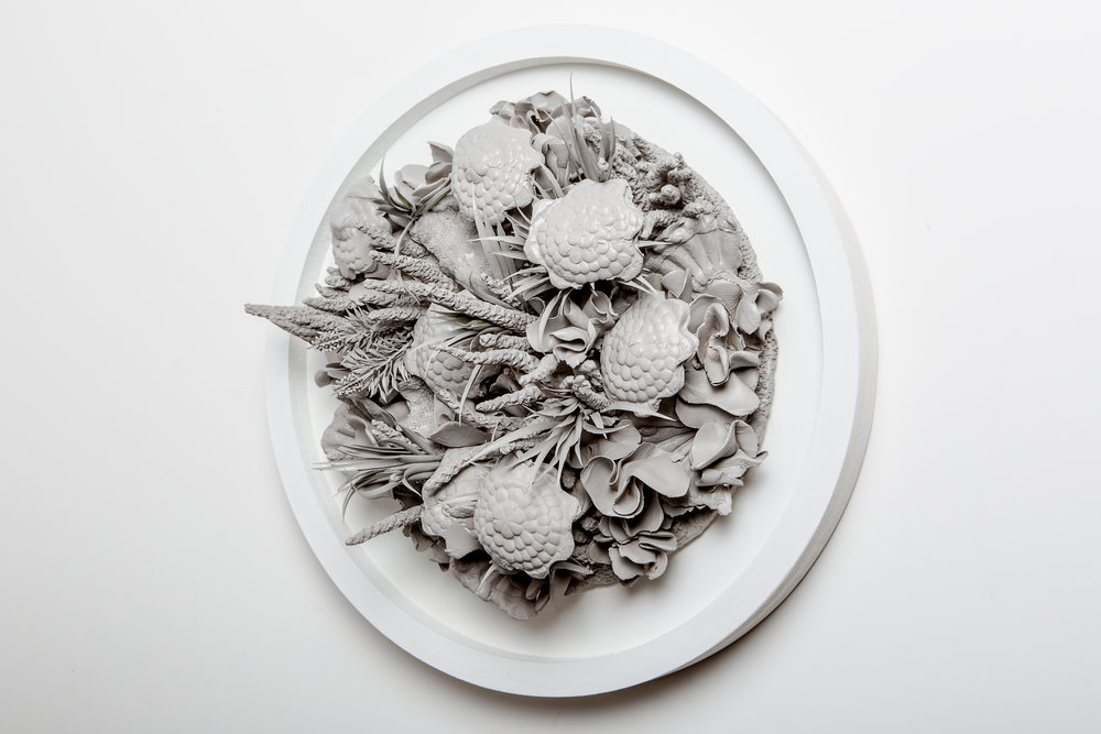 Submerge                                                         Media: White Earthenware, Wood & Synthetic Flora and Fauna Dimension: 22 inches dia.  Year: 2015