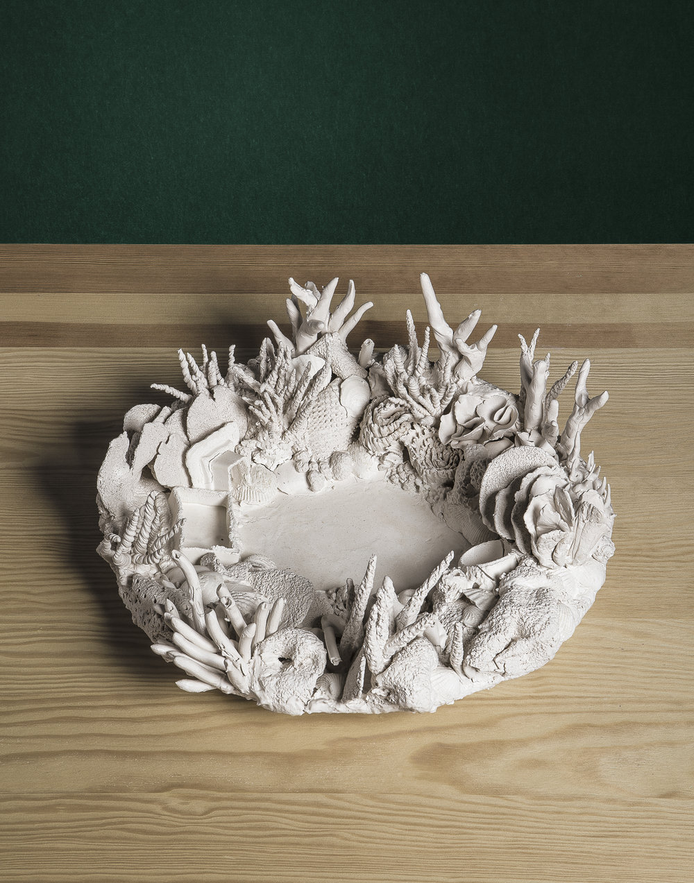 Image Detail.   Untitled Nostalgia (White Noise)  Medium: Porcelain ceramic with cast altered forms.  Dimensions: 15'' X 15 '' Diameter Year: 2017  Photography by: David Gary Lloyd
