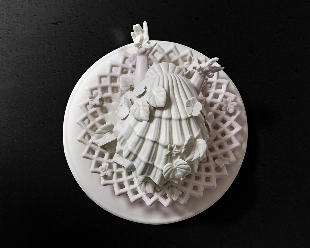 "The birth of Venus (White feminist savior of Native Land)  Medium: Porcelain ceramic with cast altered forms. Dimensions: 12"" x 12"" x 6.5"" Year: 2019  Photography by: Pedro Wazzan"