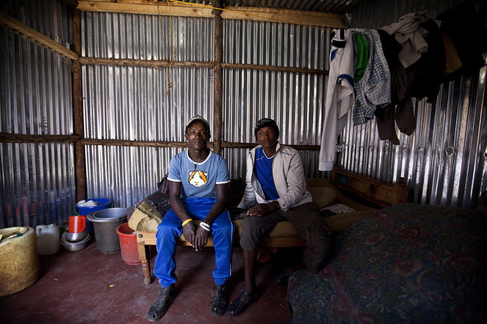John and Antony.   John and Antony met and became friends while both living on the streets of Kawangware. They now share a one room home, and split the monthly rent of 1,500 Kenyan shillings (roughly $18 CAD). (2012)