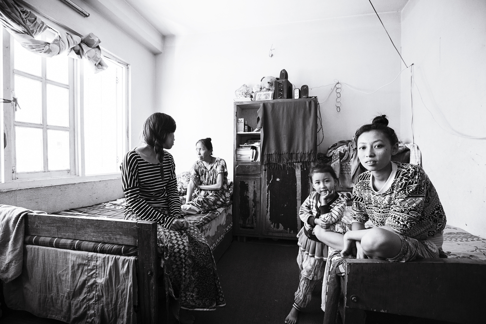Anu's family within their single room home. Left to right: Anu (21), Phoolmaya (40s), Anjika (5), Anita (14). (not pictured: brother Anil (20).