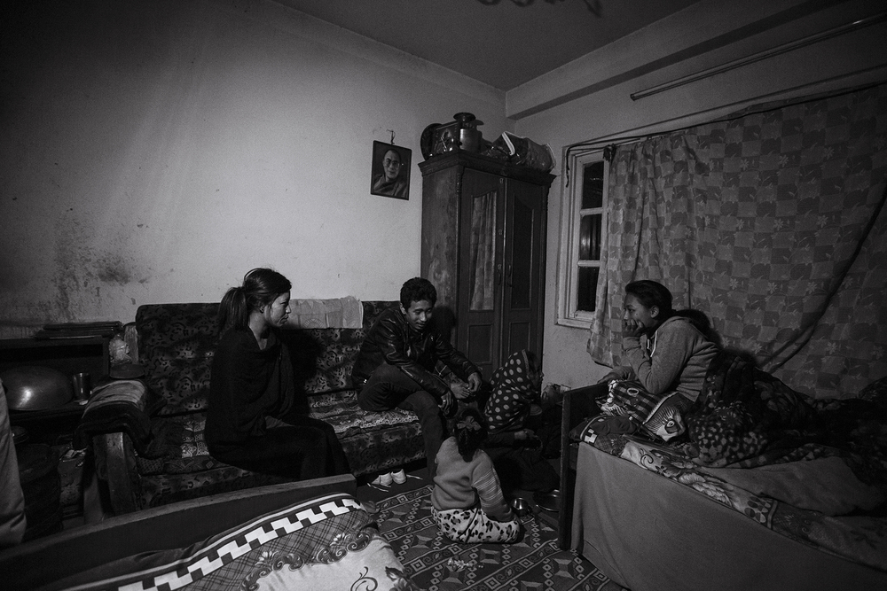 Anu's family spend the evening together in their home, prior to her departure for Egypt.