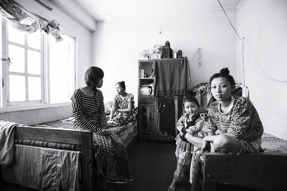 Anu (left) and her family lost their village home in the 2015 Nepal earthquake. The family relocated shortly after to a one room apartment in Kathmandu.