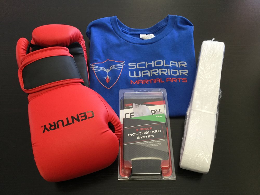 Explorer's Basic Gear Package   Includes a pair of 12oz Boxing Gloves, a school T-shirt, White Belt, two mouth guards and a case.