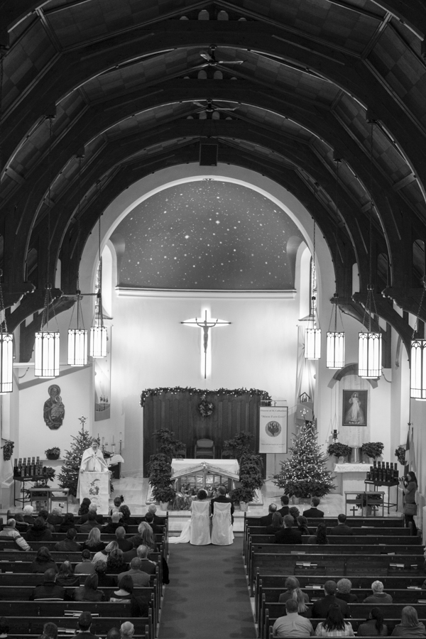 niagara-wedding-photographer-eva-derrick-photography-casablanca-winery-niagara-weddings-bride-groom-black-and-white-winter-wedding-photographers-st-catharines-church-vows-marriage-photo.jpg