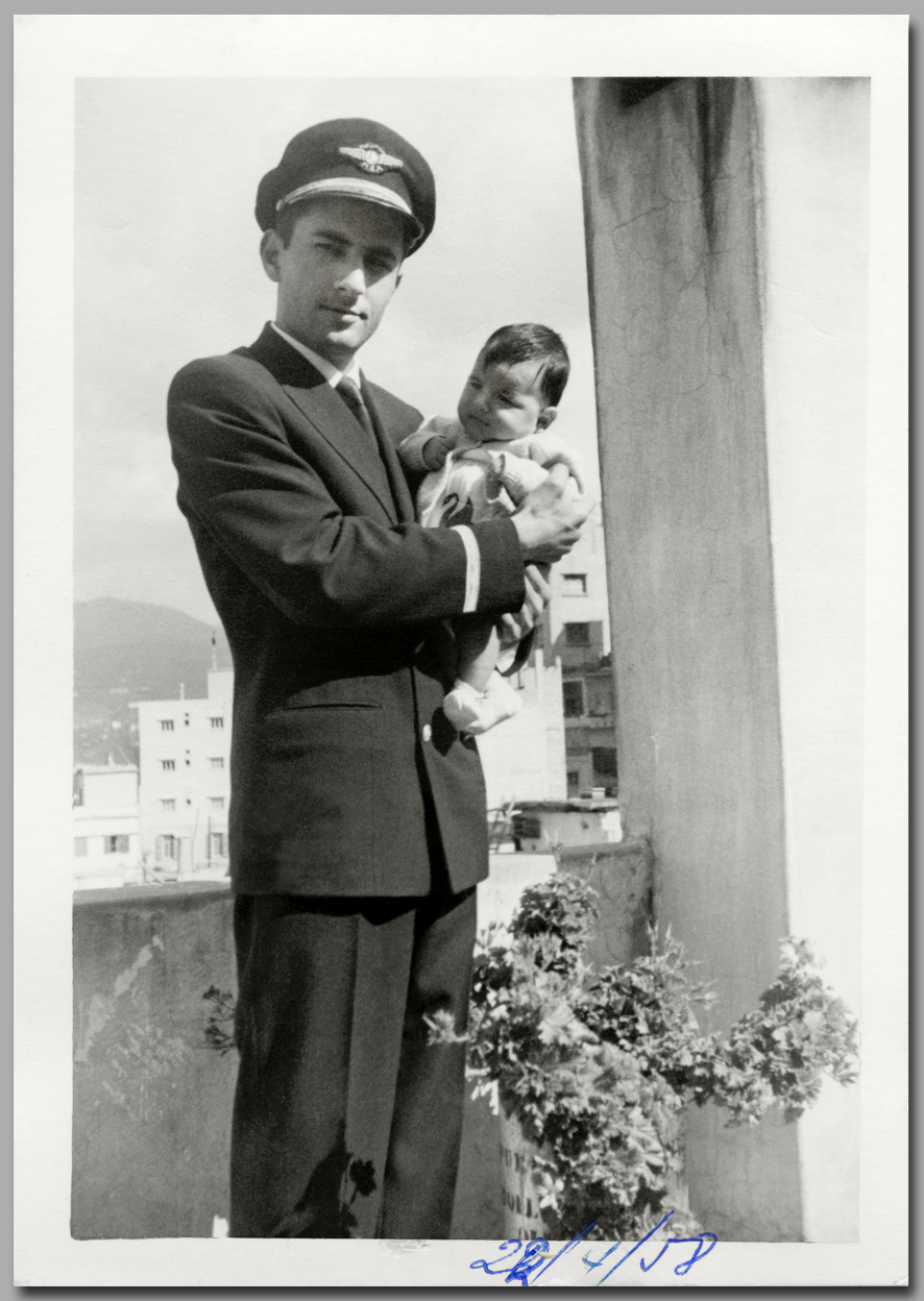 Dad in Uniform with Baby Lucien  gray.jpg