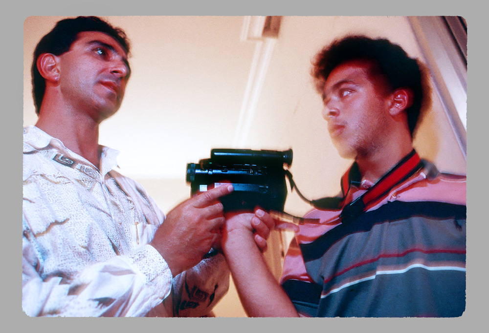 This photo of Fayez handing his video camera to his nephew Michel is  from a dinner party given at Michel's parents' home in Ashrafieh in  honor of Fayez and Melanie. This photo is known to be from 1992.