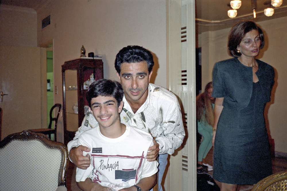 # 49  - Fayez is embracing another nephew, Jamil. Jamil's mother Solange, who's also Fayez's sister-in-law standing.     Note  Jamil's T-shirt, as well as his peach fuzz on his upper lip, as they  will both serve as indicators not present in photographs from 1991.