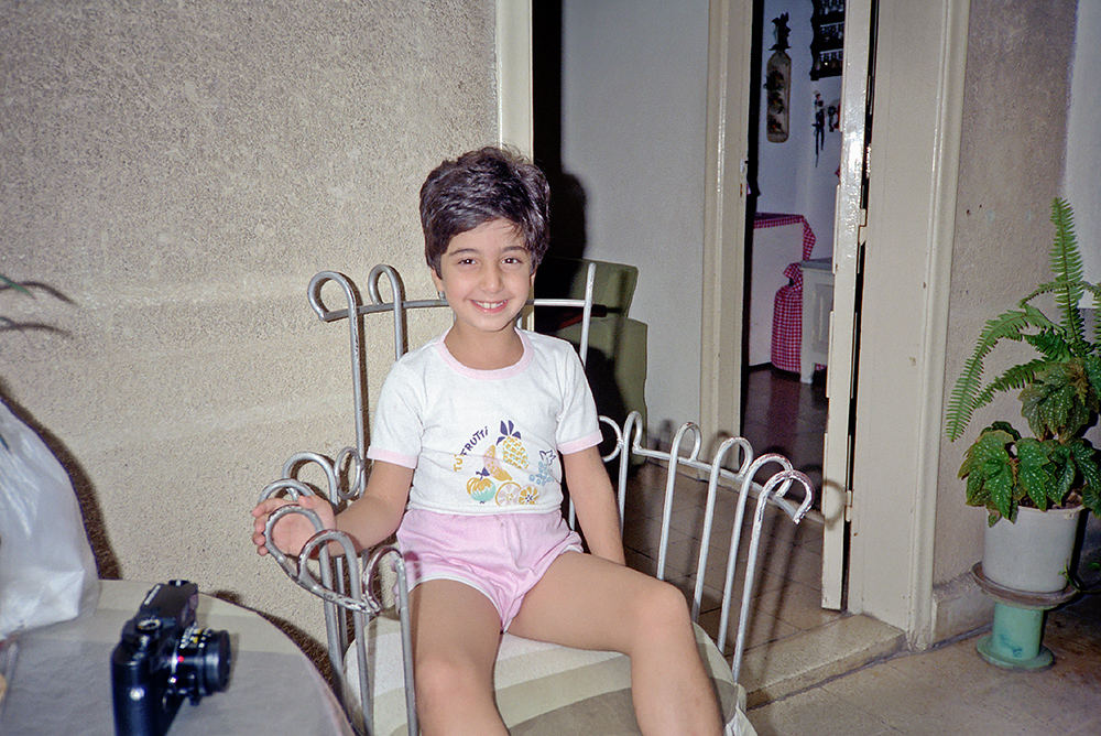 #14 - Even though the previous photograph clearly shows my cousin, the young girl, who is also on another roll #15, I am including this image here for the significance of the Leica M6 on the table, which I will discuss later.