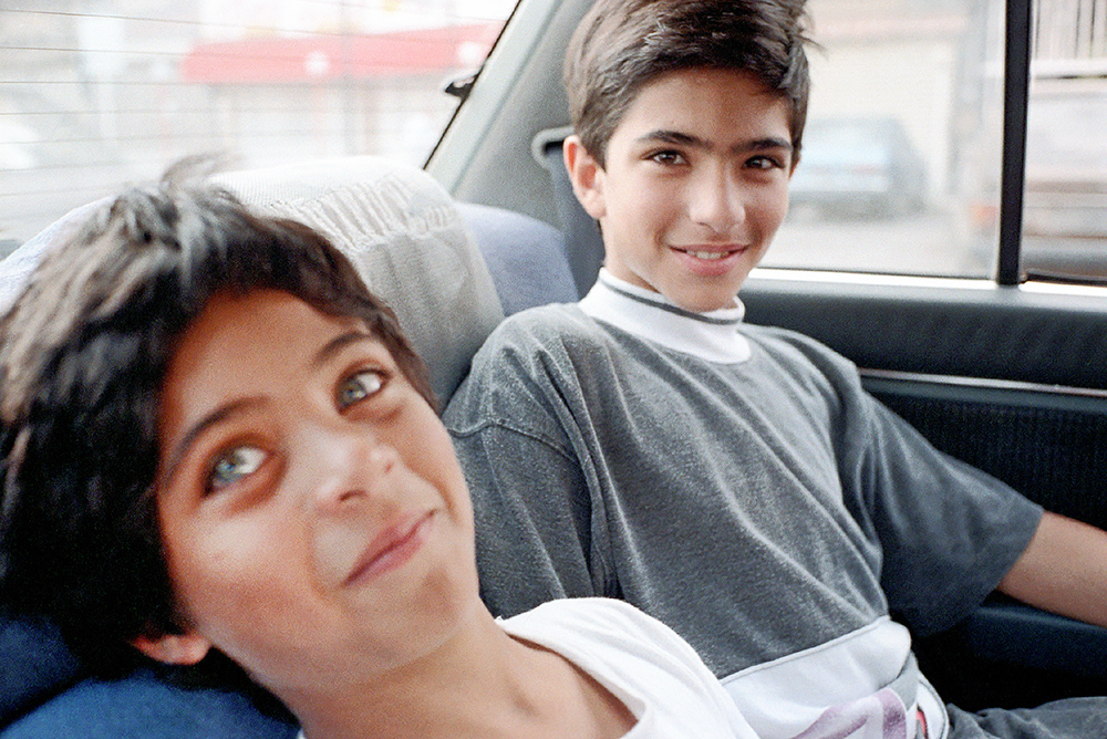 #21 - Karim with Jamil, on the same roll with Walid driving around Beirut, therefore 1991.