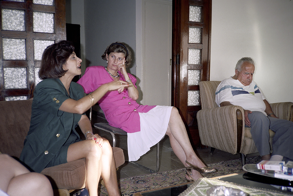 # 36  - Robert napping after one such huge meal in Ashqout as they were dropping me off to stay at my cousin Georges' for a night. Here Georges' sisters-in-law in a not untypical animated Lebanese discussion. 1991.