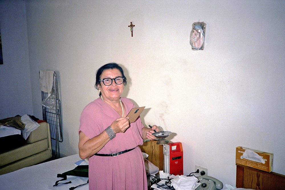 # 14  -  The same icon of Mother and Child in a photograph on yet another roll.  Loulou conducting her morning prayers with incense in front of her icons.
