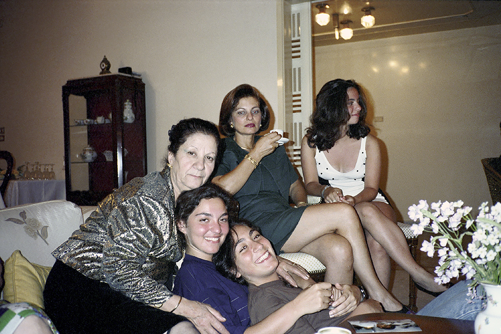 # 49  - Mathilde after dinner, with Rania, Rhea, Solange and Samar. 1992