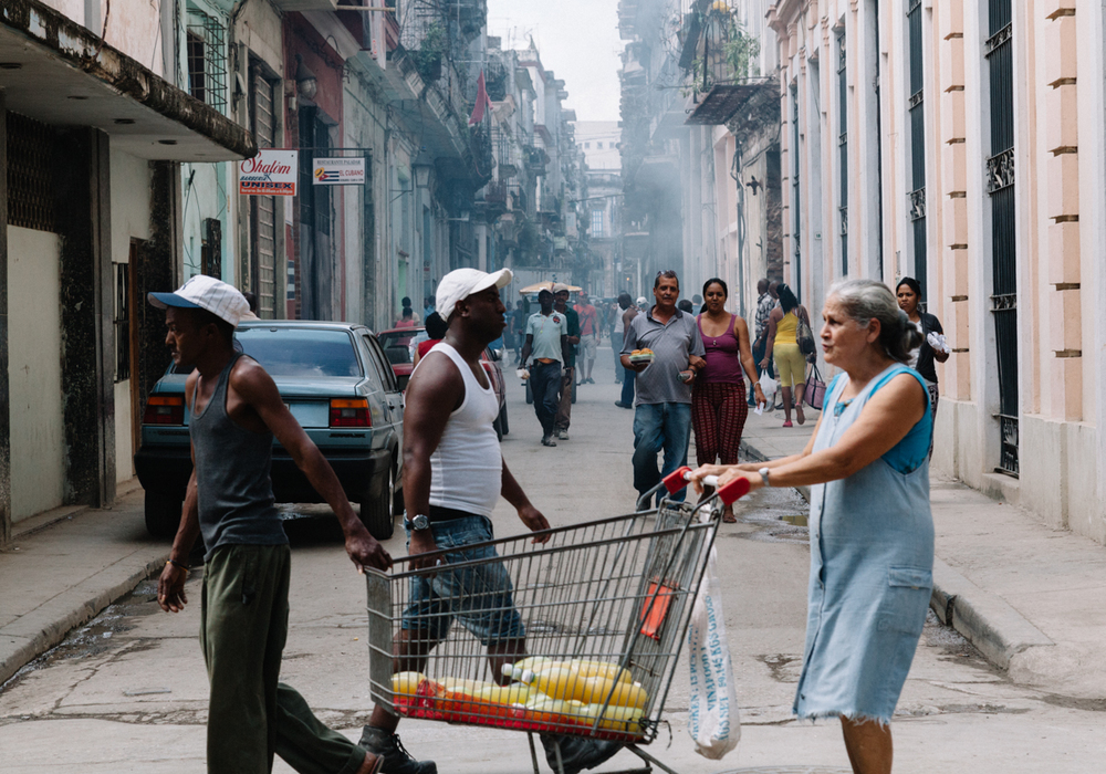 A lady sells black market juice in the streets of Havana Vieja