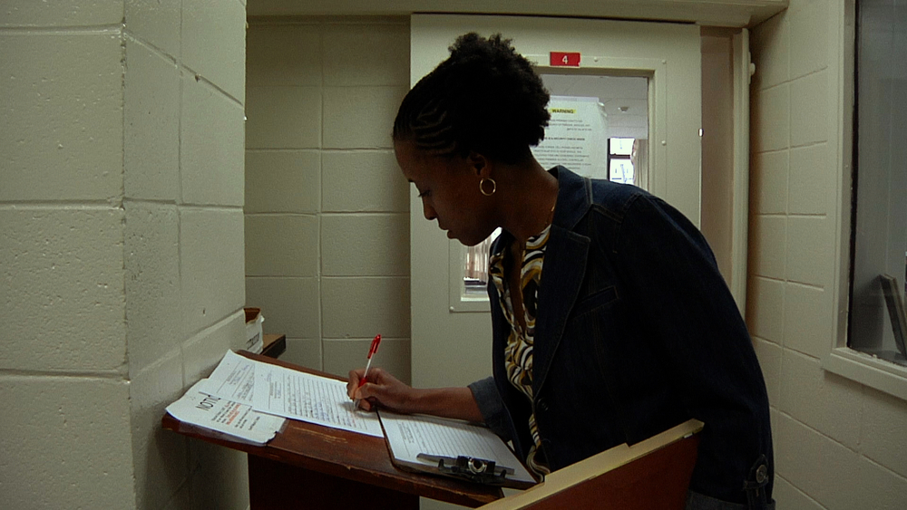 Public defender June Hardwick signs in at Jackson County Jail in Jackson, MS © 2013 HBO Documentary Films