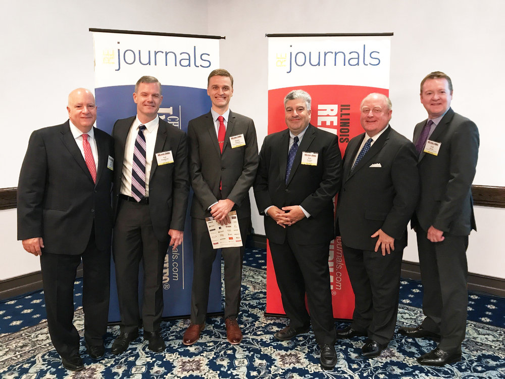 Pictured above, from left to right: Sam Delisi, NGKF; Neil Pendleton, CBRE; Daniel Hanson, Mid-America Asset Management, Inc.; Bob Assoian, NAI Hiffman; Bob Six, Zeller Realty Group; Niall Byrne, Inland Investment Real Estate Services.