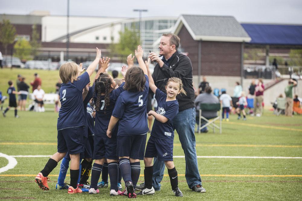 Girls Soccer with Coach.JPG