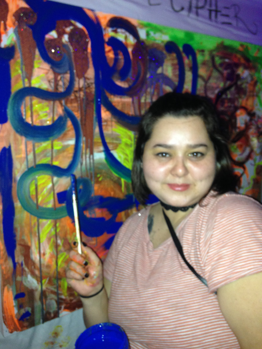 - Julie Hernandez showing off group painting at The Castle (Brooklyn, NY)