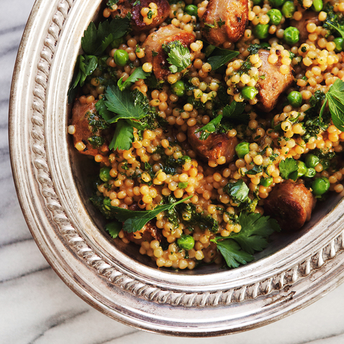 Israeli Couscous Risotto With Peas, Sausage + Parsley Pesto