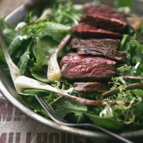 steak salad with grilled ramps + tomato vinaigrette