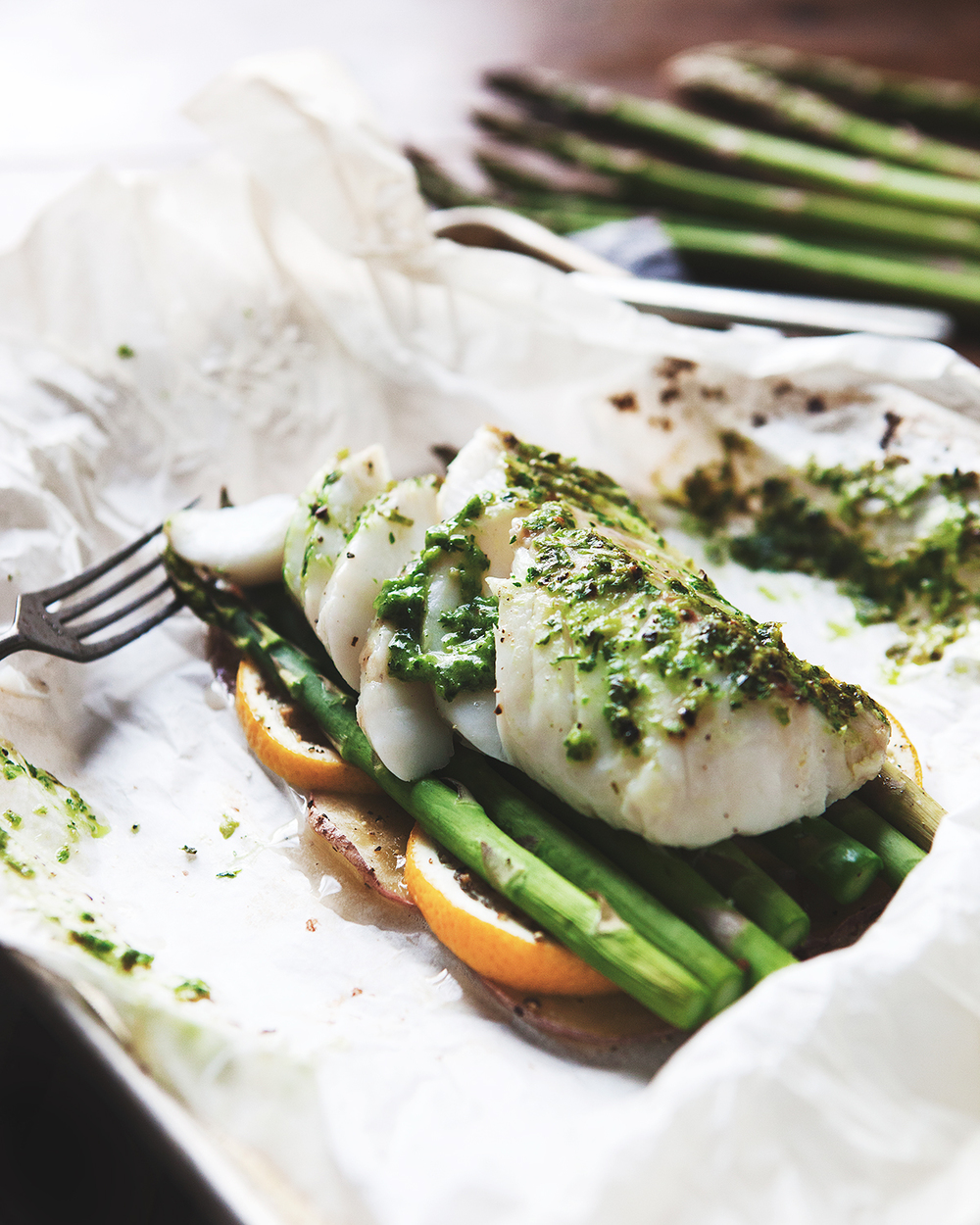 cod en papillote with potatoes, asparagus and scallion pistou
