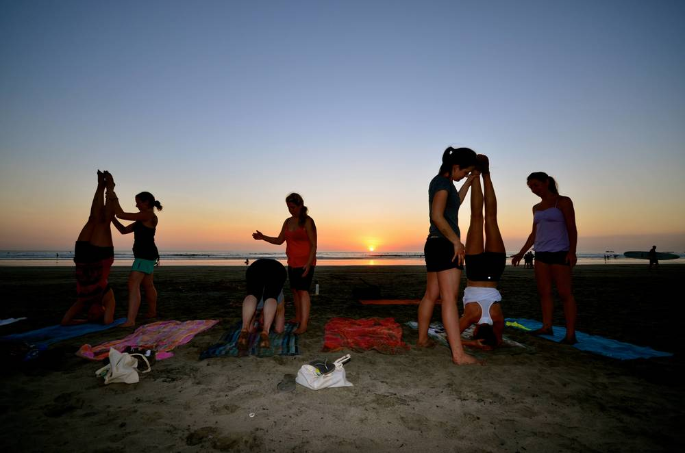 Students at my 2013 Costa Rica Yoga Retreat learning how to do headstands in the sand.