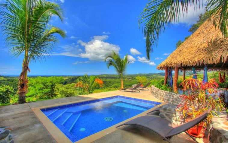The pool and yoga palapa