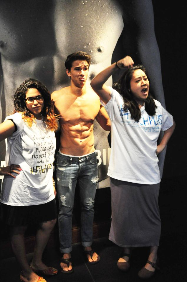 Interns from DoSomething.org pose with a male A&F model (c/o DoSomething.org)