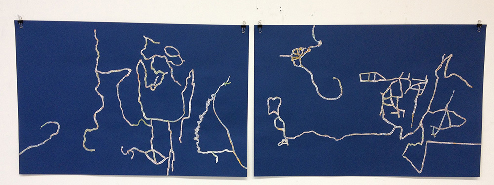 Early in the collage process. Cutting out the roads and attaching them to the paper.