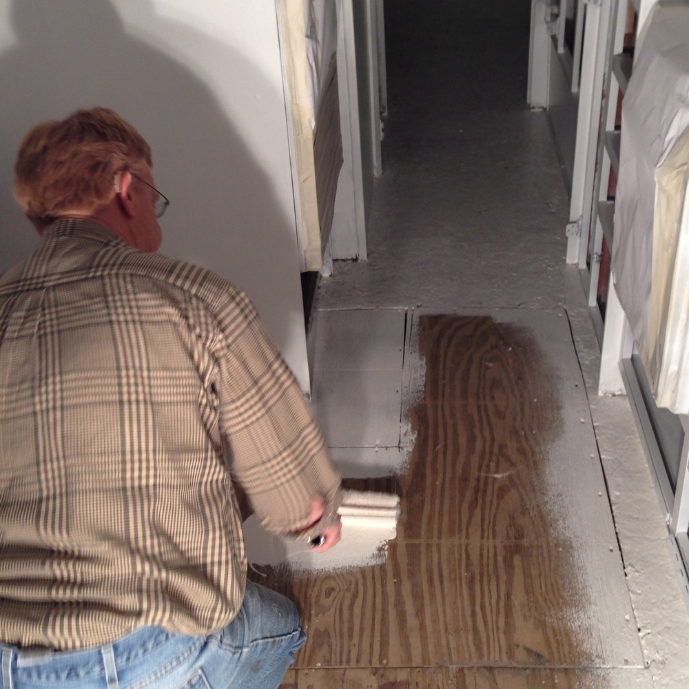 Bob, painting the floor where the dinette has been removed.