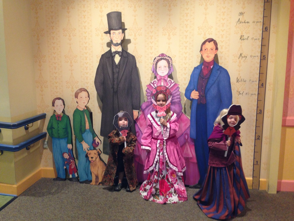 The kids dressed up at the Lincoln museum.
