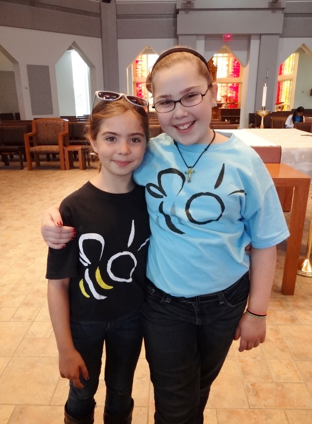 "Natalie & Gabby wearing the ""Bee"" shirts"