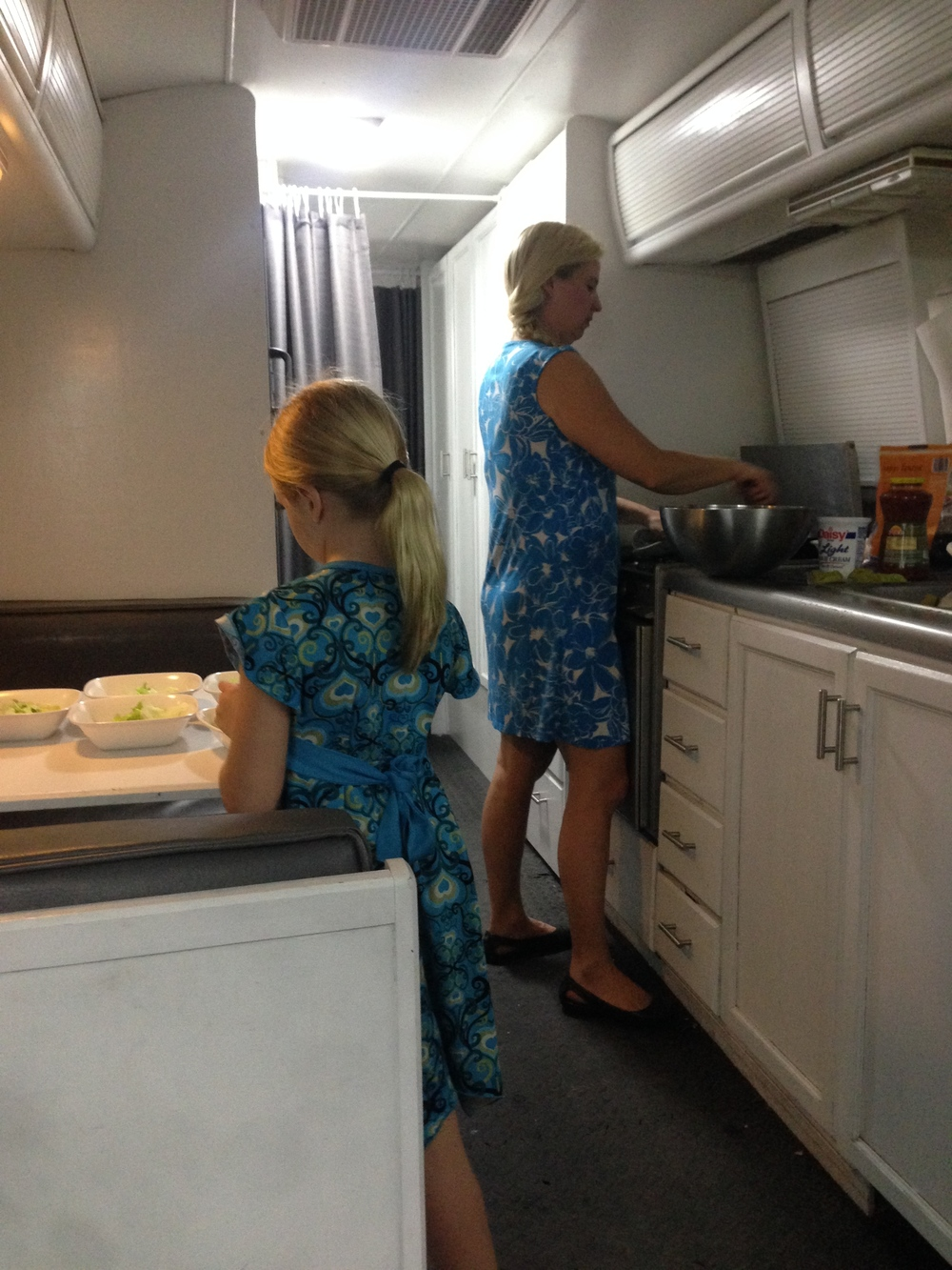 Michelle (& her twin Trinity) getting a meal ready.
