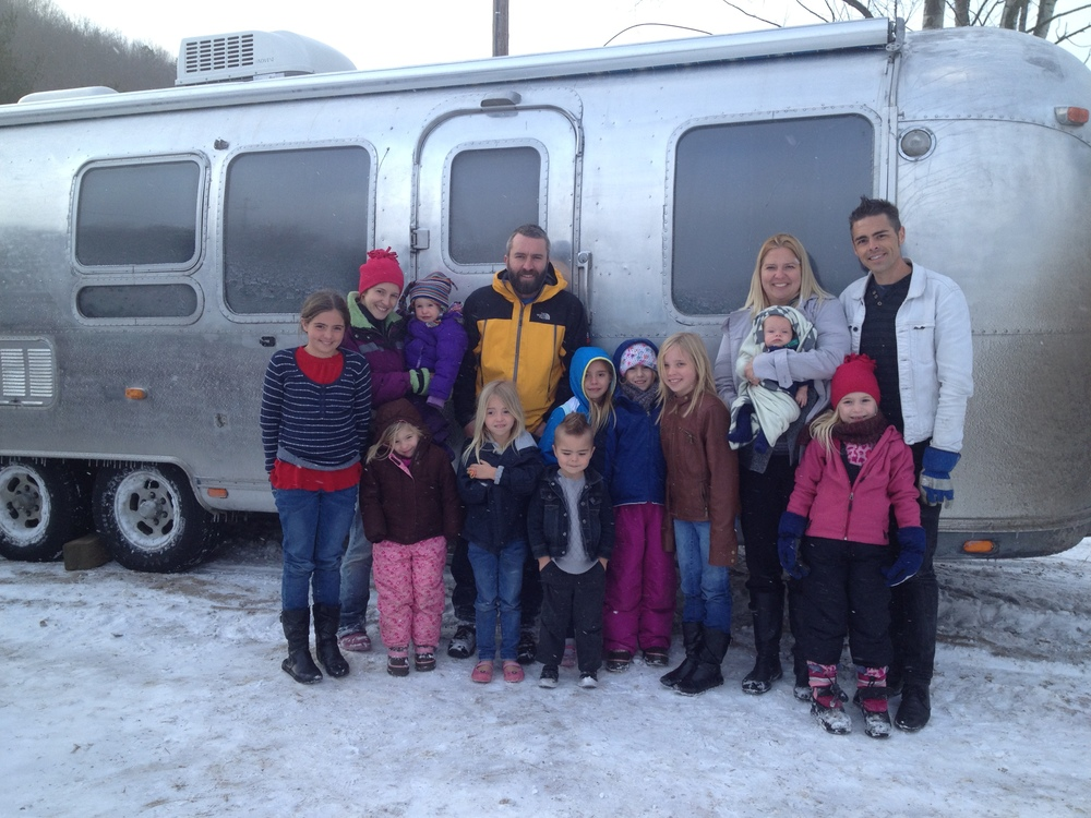 The Mette family with the happy new owners - we're so cold!