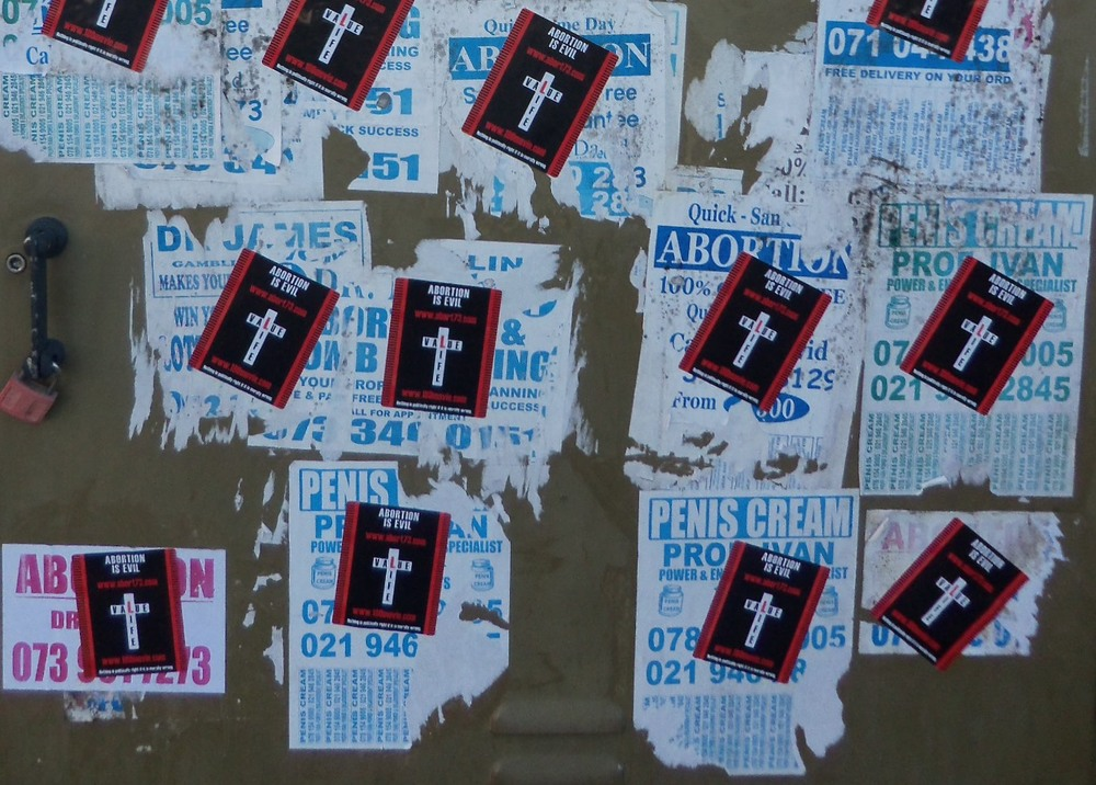 Value Life stickers over the abortion (and other) posters