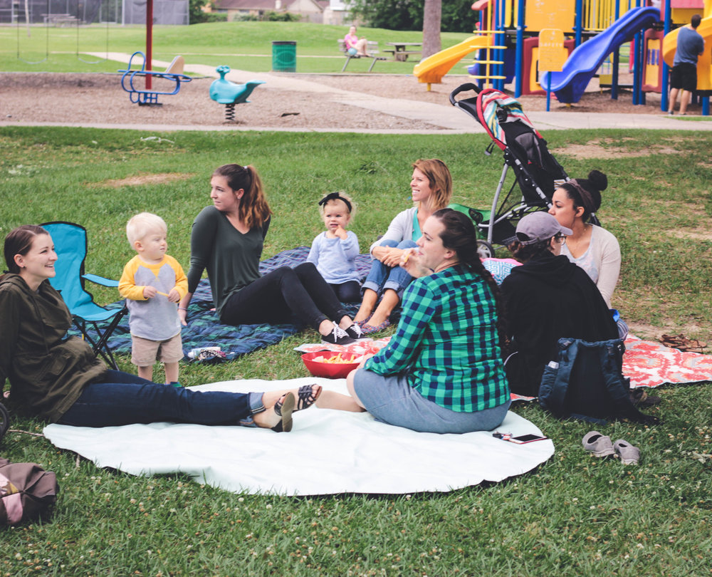 Several ladies from the church are gathered around at Rogers Park during the cookout. Featured in the photo from left to right: Esther Jean, Henry Jean, Caitlyn Boyd, Molly Pratt, Mandy Pratt, Sarah Jean Childress, Megan Boyd, and Laura Maddux.