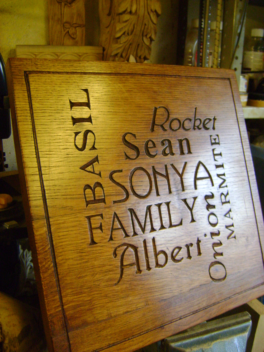 An oak 'Family' wall plaque