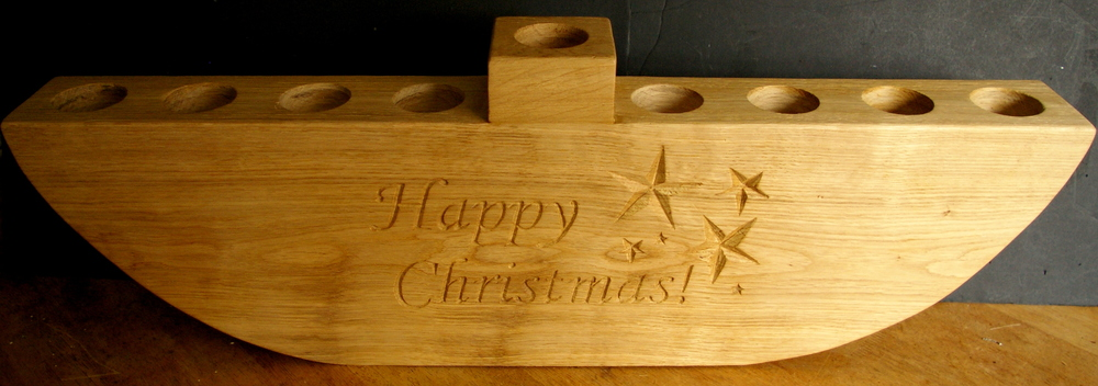 A substantial oak candle holder, measuring 82cm wide and 23cm high it doubles up for both Hanukkah and Christmas!