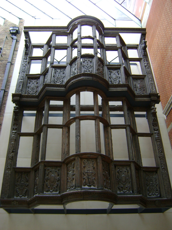 The facade of a house dating from 1600 with carved panel and corbel brackets.