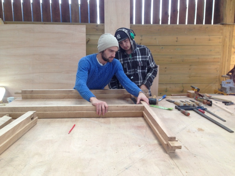 Steve and Jim working on the oak window frame.