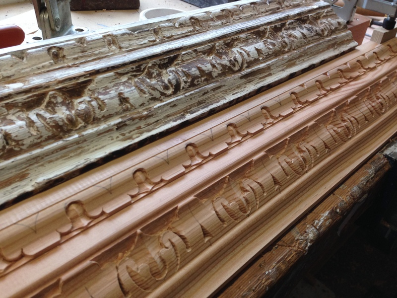 The original moulding above the newly carved replacement dado moulding.