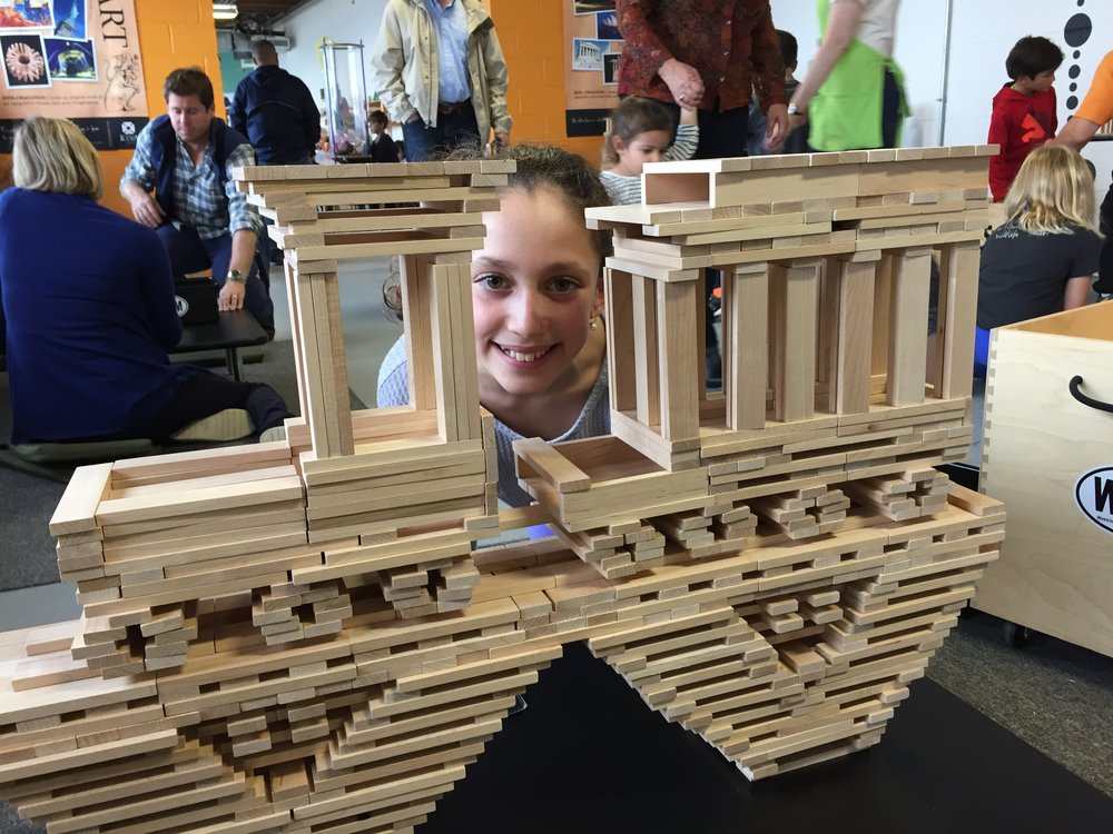This young architect designed a train crossing a bridge using critical thinking skills, creativity, and ability to experiment with force and balance in the Construction Design Zone
