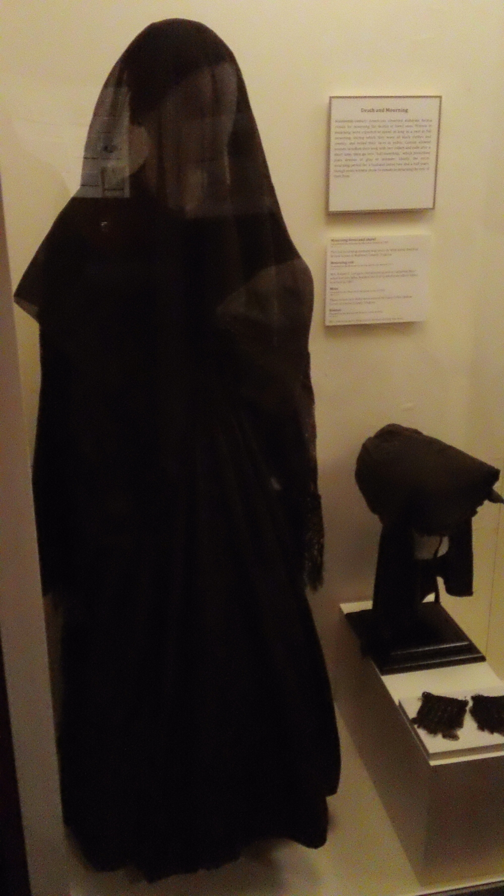 Mourning garb.  The veil you see was given to this particular widow as gift of Mary Custis Lee, wife of Robert E. Lee.