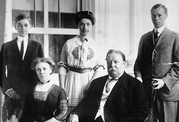 William Howard Taft (seated) and son Robert (standing left) would leave their mark on American politics.